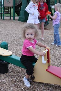 Little Girl on Playground Toy